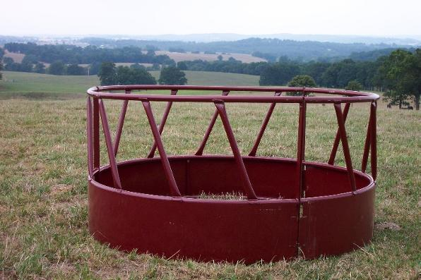 Round bale feeder vs. net, ponies and horses - The Horse Forum